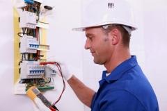electrician measuring voltage